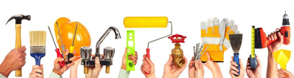 Hands holding handyman tools
