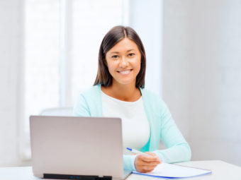 business, education and technology concept - asian businesswoman or student with laptop and documents in office