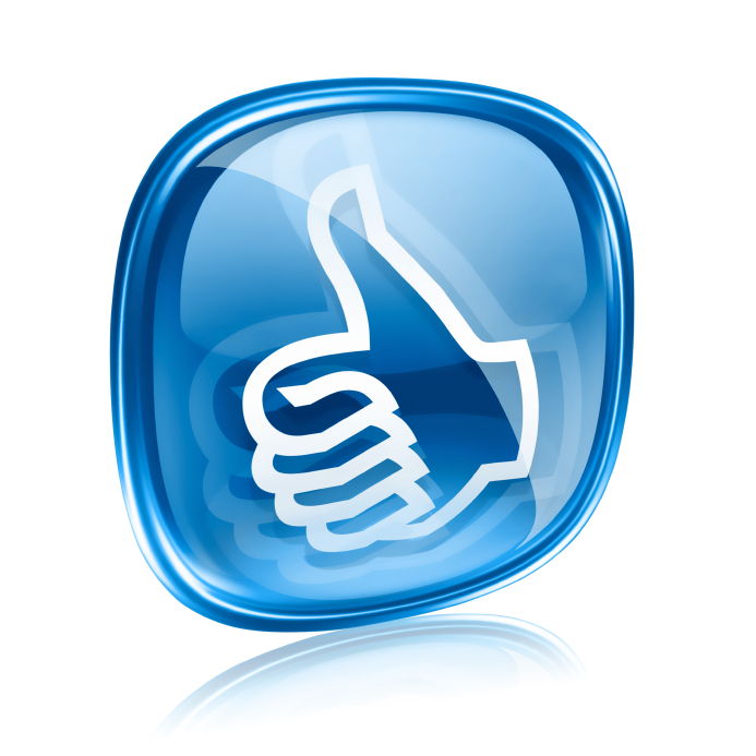 Blue thumbs up icon on glass