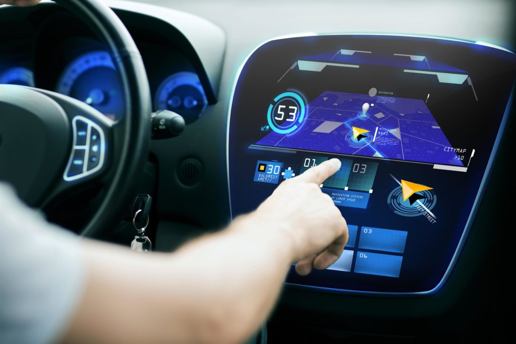 Man's hand using GPS navigation in car