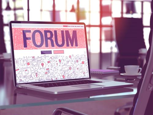 Laptop screen with big headline FORUM _pink background_logo collage showing on bottom half of screen