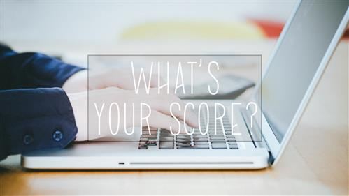 Man's hands typing on laptop keyboard with WHAT'S YOUR SCORE superimposed across image