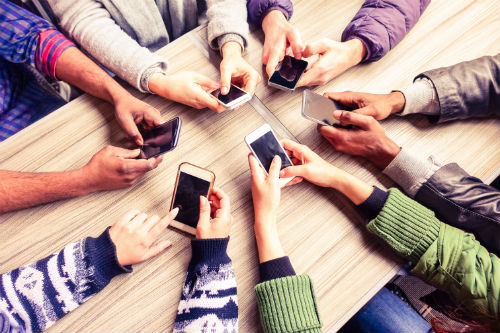Group of People with Phone Having a Good Mobile User Experience